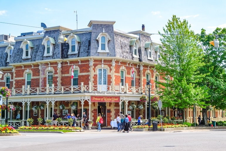 old hotel on street corner with red brick and gardens in niagara on the lake