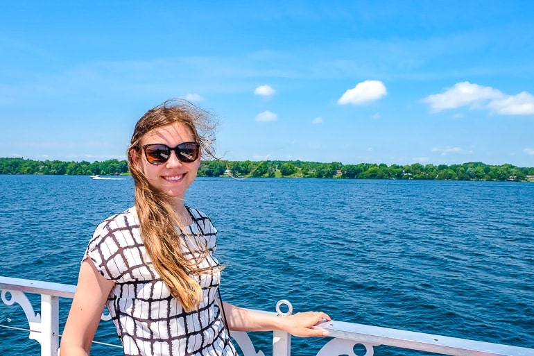girl with sunglasses on edge of boat thousand islands boat cruise