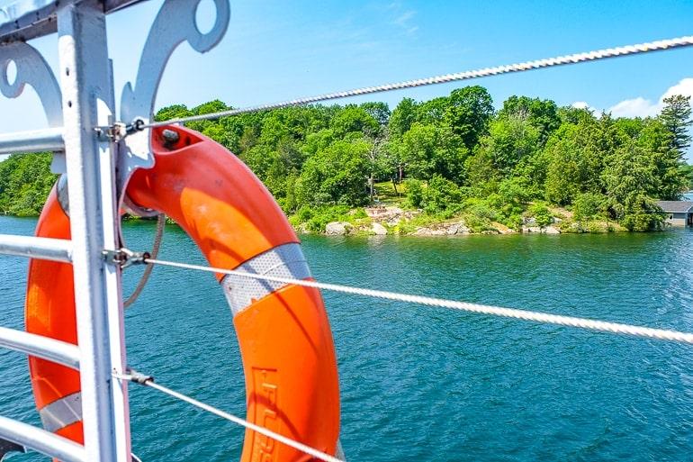 orange safety ring on side of boat deck thousand island cruise