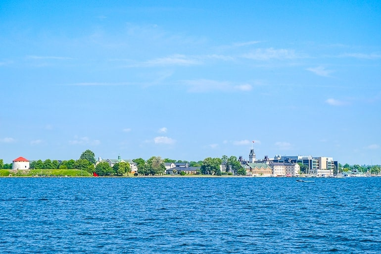 historic building on shoreline across the water kingston waterfront thousand island cruise