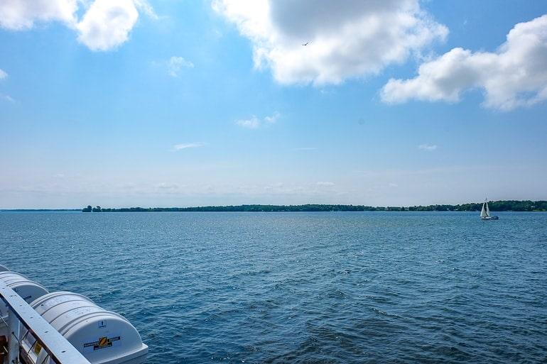 sailboat in blue water with land in back ground while on boat cruise