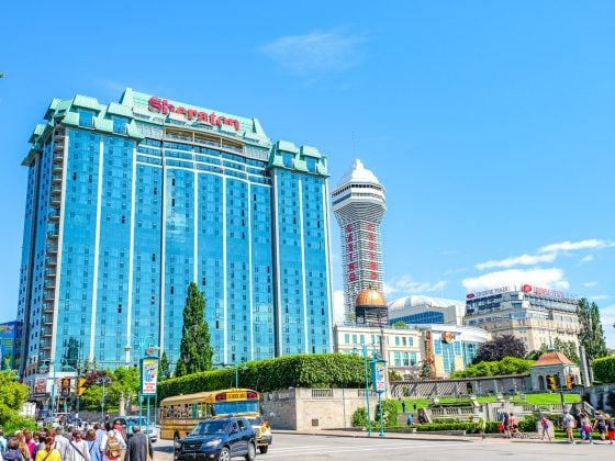 glass hotel with tower beside and blue sky where to stay in niagara falls accommodations sheraton