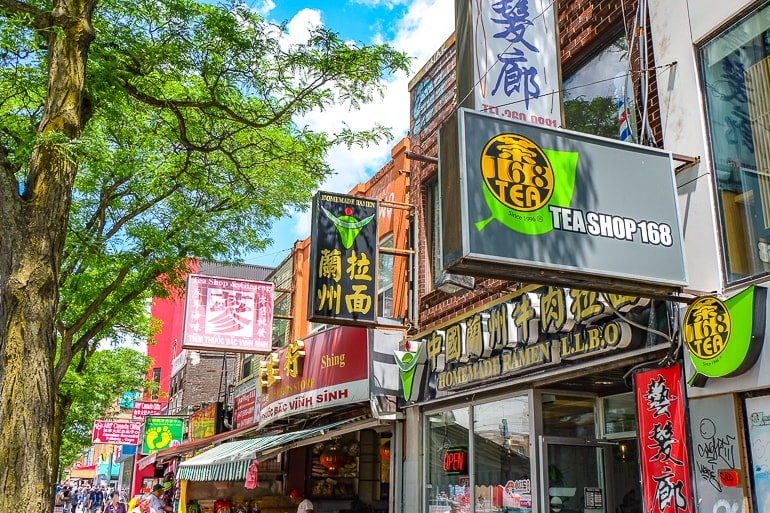 Asian signs to shop fronts in chinatown in toronto