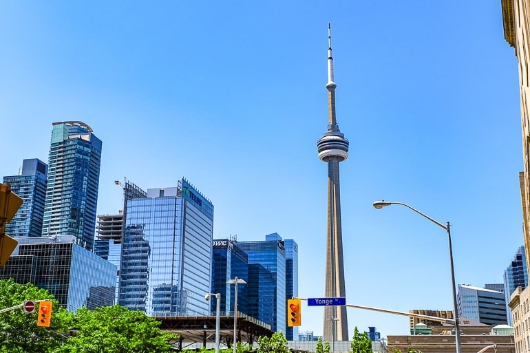 cn tower in toronto with skyscrapers and luxury hotels beside