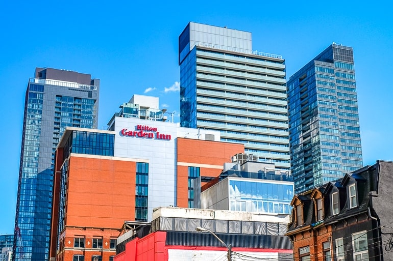 hotel building among other tall buildings in downtown area toronto