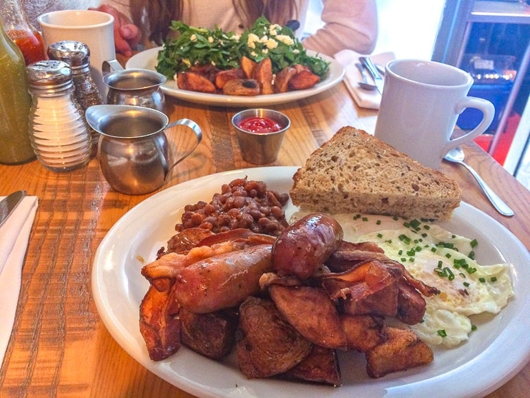 two plates of brunch food on wooden table wilf and ada's ottawa