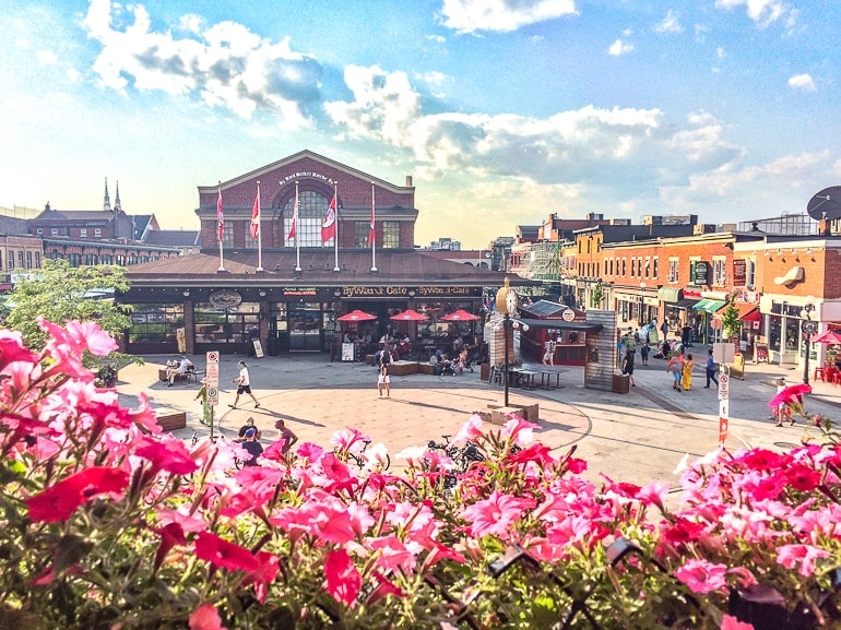 market hall from above with flowers and people in front byward market ottawa in a day