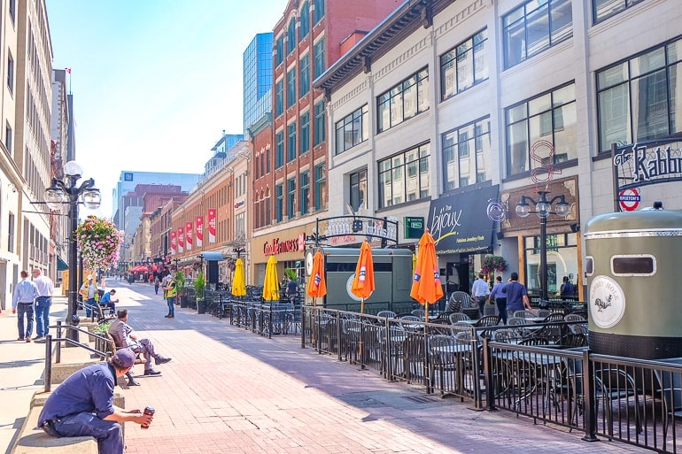 long pedestrian street with patios and people sparks street in ottawa