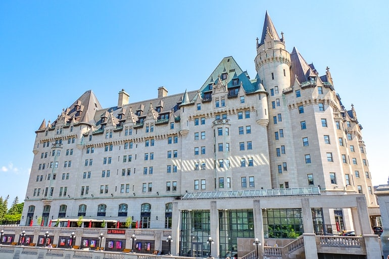 white old hotel with blue sky behind chateau laurier one day in ottawa high tea