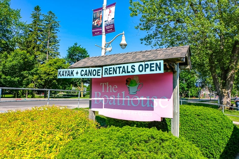 pink sign with shrubs in front the boathouse guelph things to do in guelph ontario