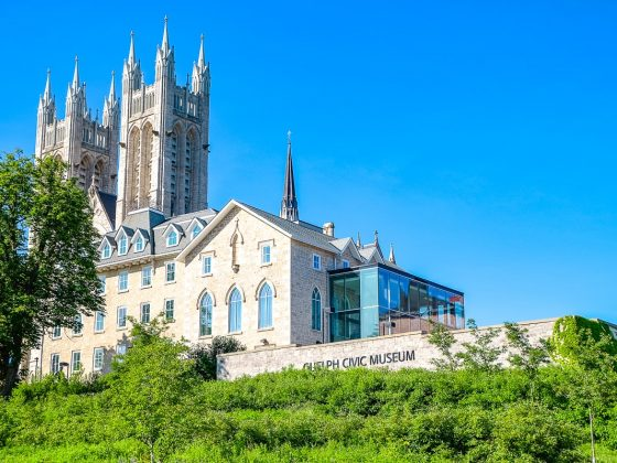 church towers and stone museum with trees in front things to do in guelph ontario