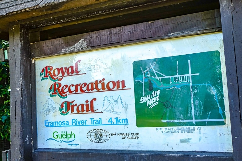 wooden sign with trail directions things to do in guelph ontario