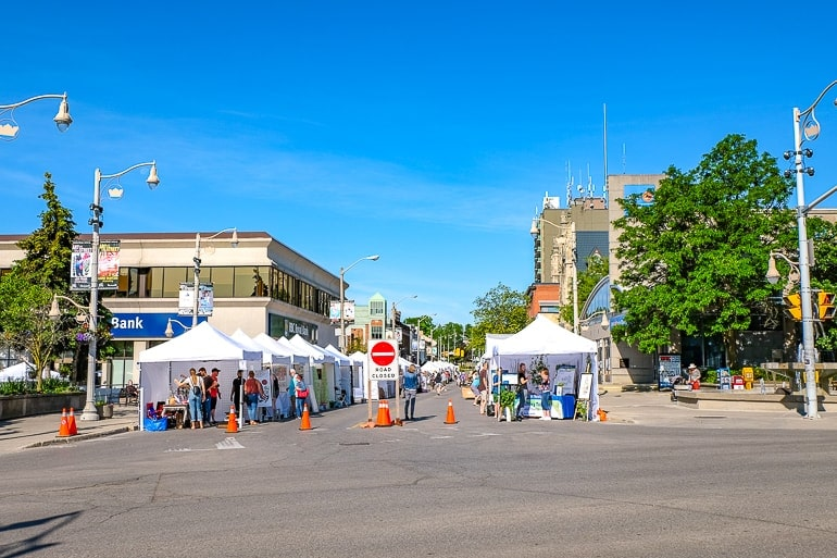 white pop up tents on paved road guelph ontario festival