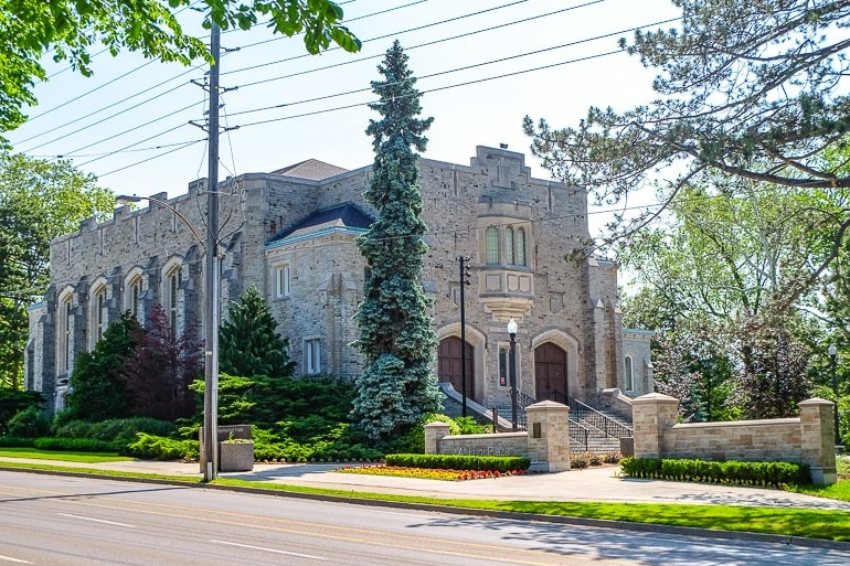 grey stone building beside road in guelph