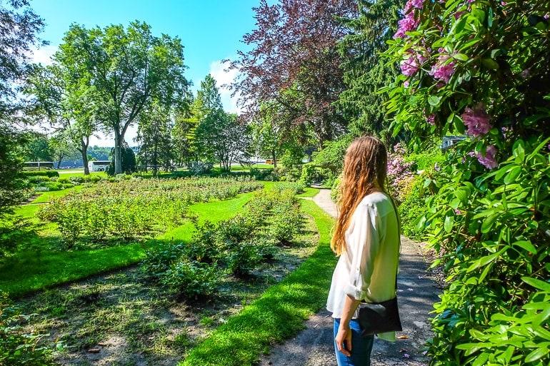 woman exploring green gardens with flowers niagara falls canada