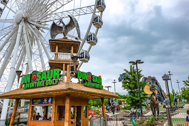 dinosaur on top of wooden hut with ferris wheel behind things to do niagara falls canada