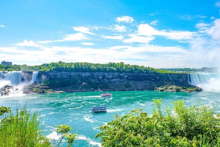 two boats passing in blue niagara river things to do niagara falls