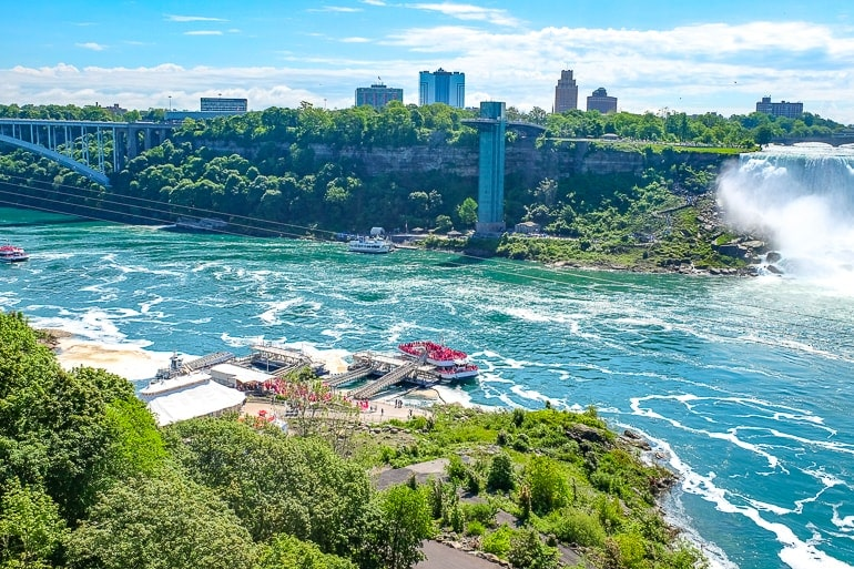 boat loading with people in blue niagara river for hornblower cruise in niagara falls canada
