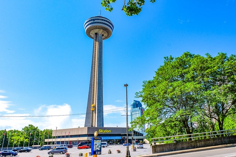 tan tower with observation deck and parking lot below skylon tower niagara falls things to do