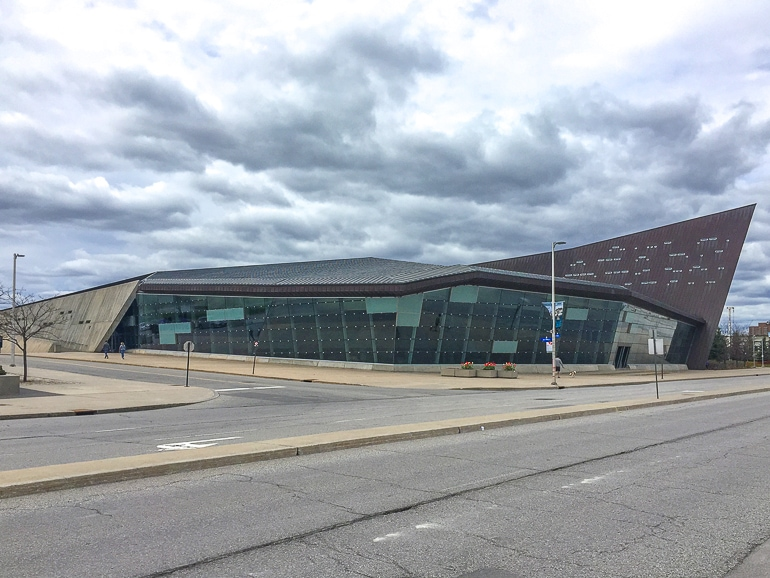 grey and concrete museum building with road in front canadian war museum in ottawa canada