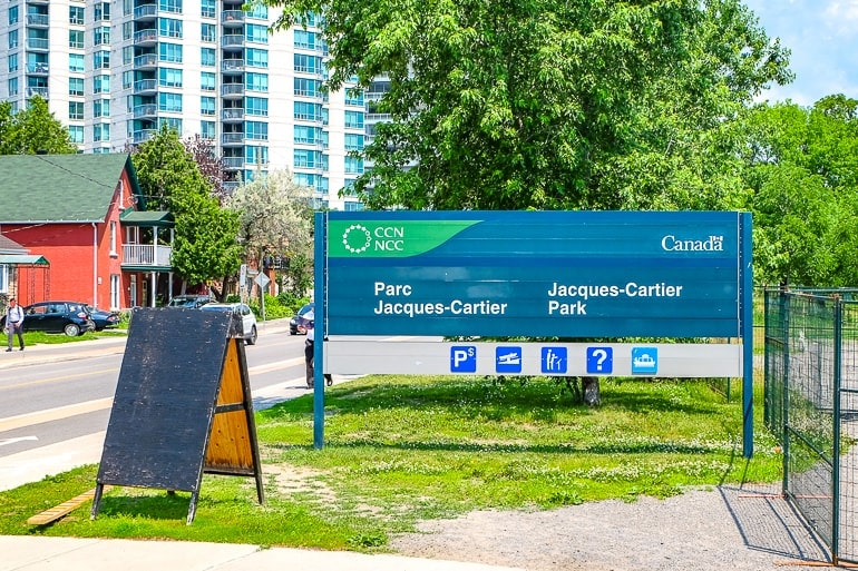 blue and green park sign on green grass jacques cartier park things to do ottawa canada