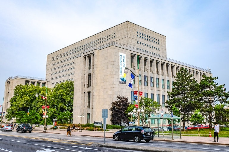 large square building with windows and trees in front LAC ottawa canada things to do