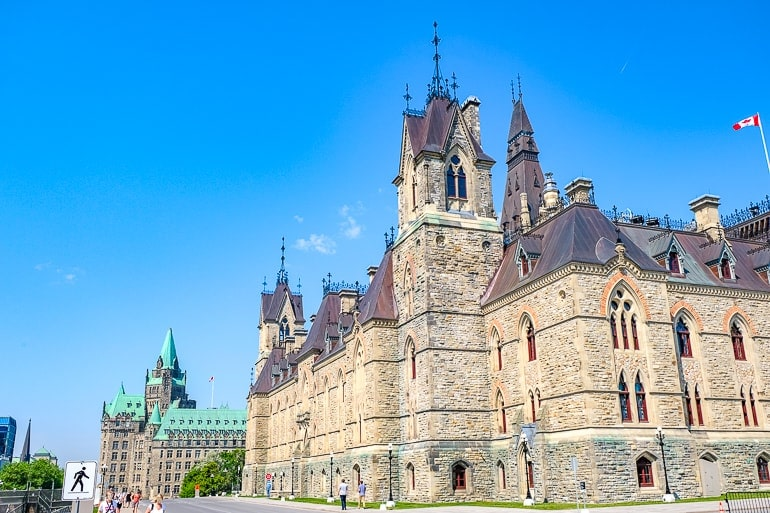 old stone building with brown roof east block parliament ottawa canada