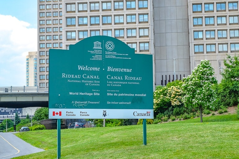 green sign over green lawn by rideau canal things to do in ottawa canada