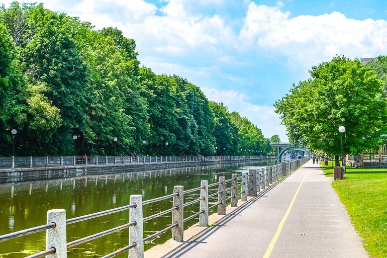 long canal with trees and sidewalk beside things to do in ottawa canada