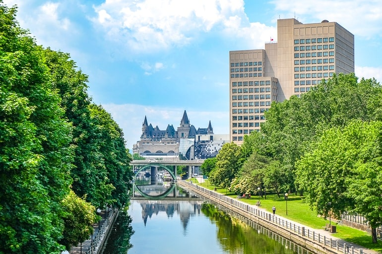 canal reflecting large building with trees lining it rideau canal ottawa canada