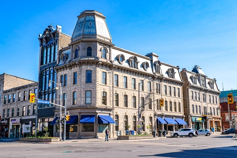 downtown buildings with cars parked on street toronto to guelph driving