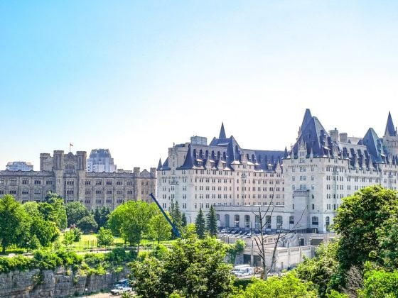 large hotel with trees and blue sky where to stay in ottawa canada