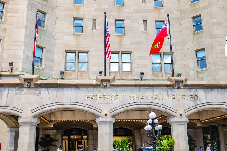 gold lettering of hotel entrance with flags chateau laurier ottawa luxury hotel
