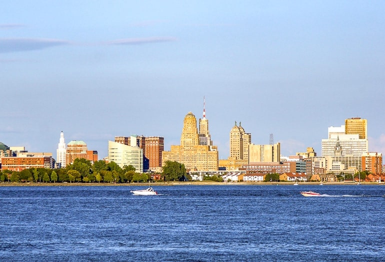 city skyline with blue lake and speedboat in front buffalo new york day trip
