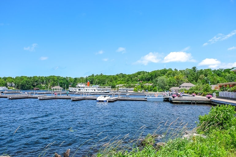 blue lake with docks and ferry parked gravenhurst ontario day trips from toronto