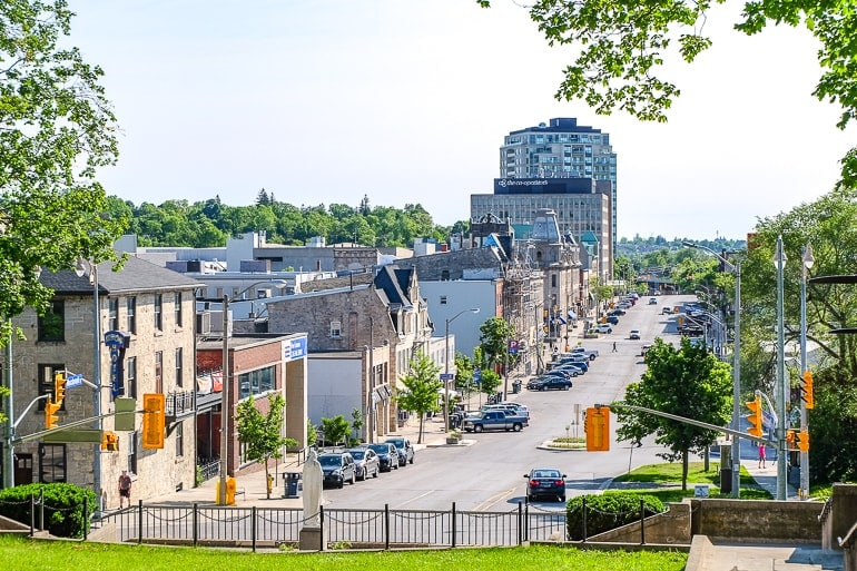 small city buildings and main street through green trees guelph ontario day trip