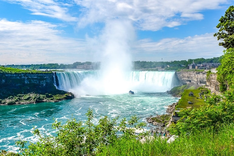 waterfalls with boat approaching and mist day trips from toronto niagara falls