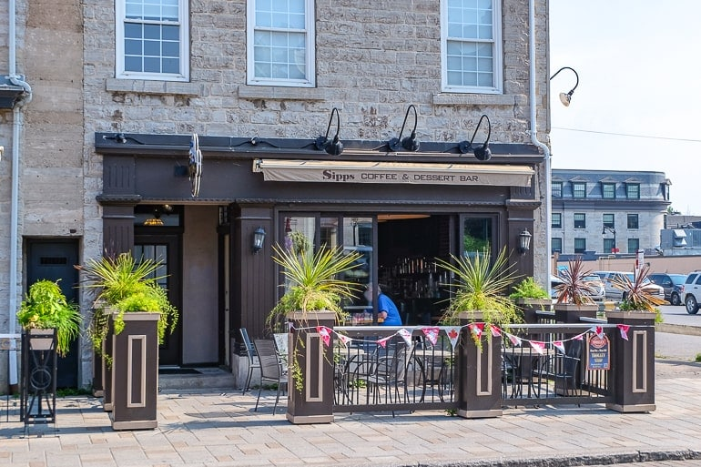 coffee shop storefront with green plants on patio sipps kingston ontario