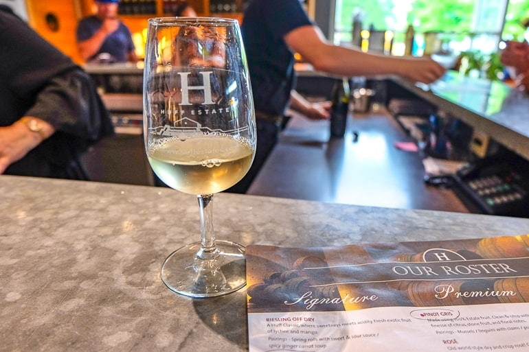 wine tasting glass on counter with paper beside at huff estates winery