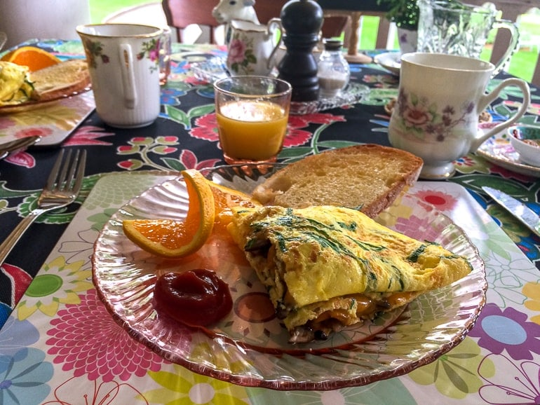 omelette on plate with fruit and coffee on table at bed and breakfast montrose inn