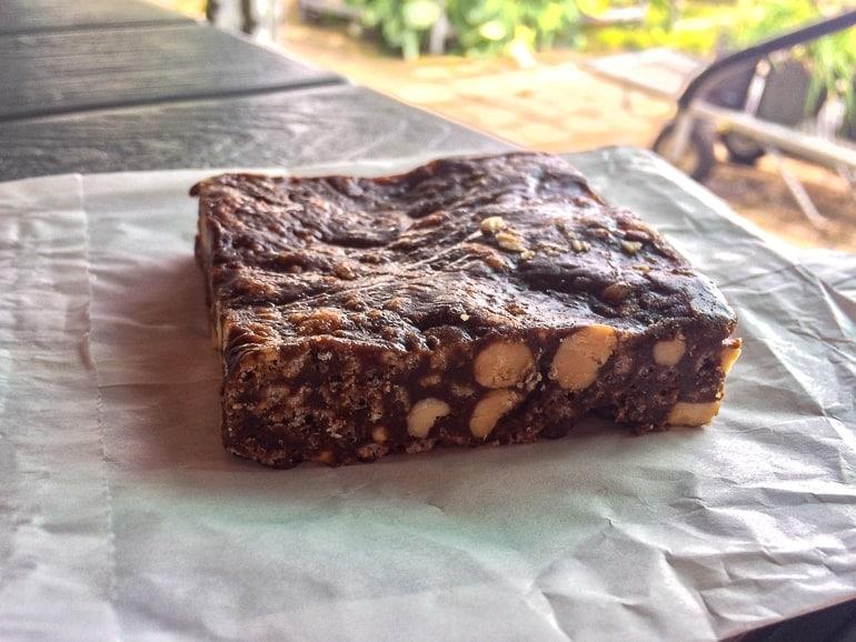 chocolate peanut butter bar on napkin on table