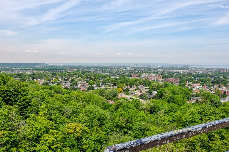 viewpoint overlooking hamilton ontario with green trees and houses below