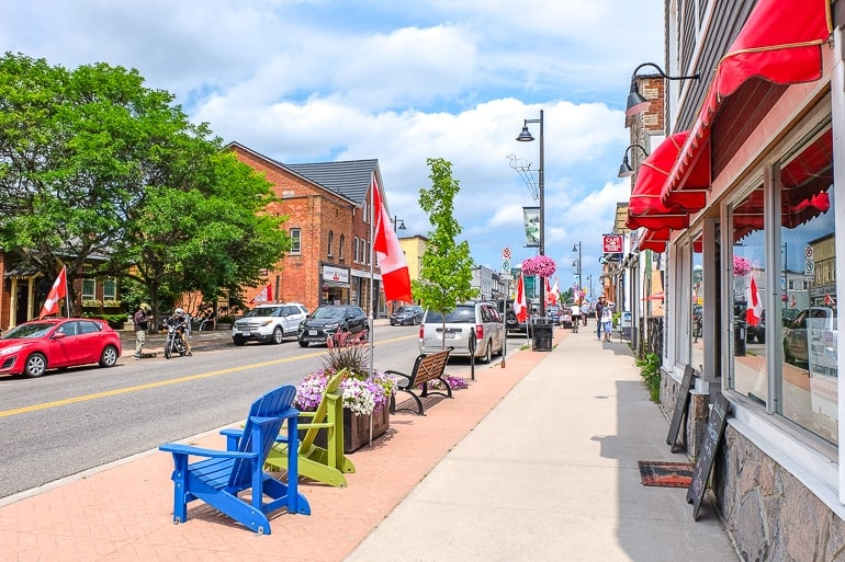 small town street with colourful chairs and flags in gravenhurst ontario