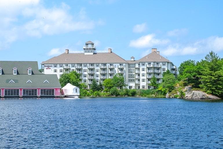white hotel building across blue lake in gravenhurst ontario