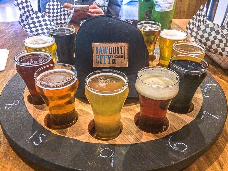 beer samples in wooden circle with hat in middle sawdust city brewery gravenhurst