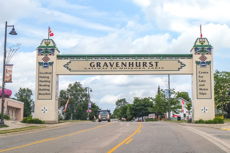 large white welcome gate across town street things to do in gravenhurst ontario