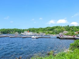 blue lake with wooden docks and ship parked things to do in gravenhurst ontario