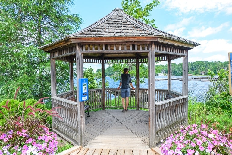 man standing in wooden gazebo with flowers things to do in gravenhurst ontario