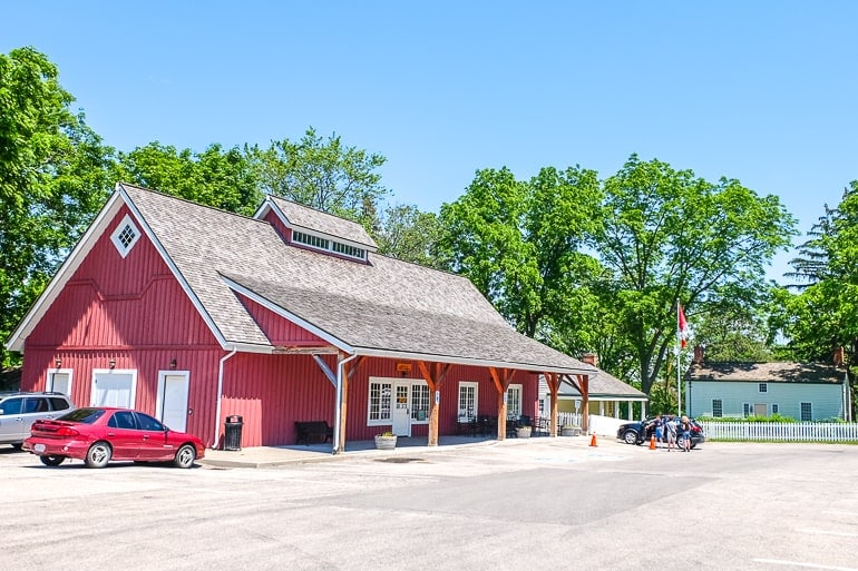 red barn in parking lot for historic site laura secord house niagara on the lake