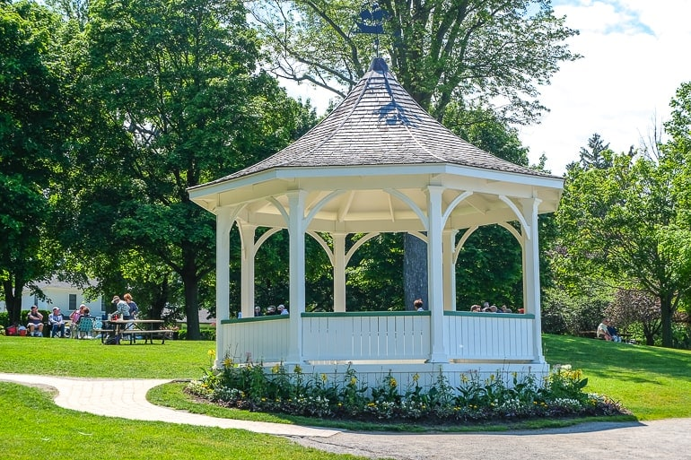 white gazebo in green park by shoreline things to do in niagara on the lake